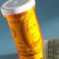 Picture of money in a pill container.