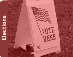 "image of ""vote here"" sign"