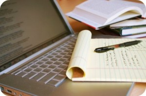 image of laptop, book & writing tablet