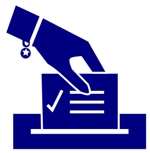 hand dropping ballot into box