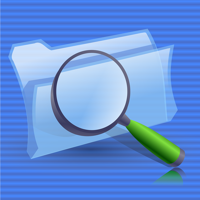 image of file foders with a magnifying glass