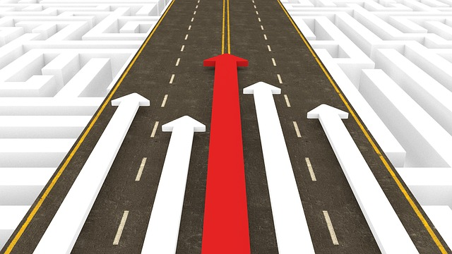 image of directional arrows pointing up a road, symbolizing leadership