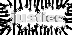 image of black hands surrounding the word Justice